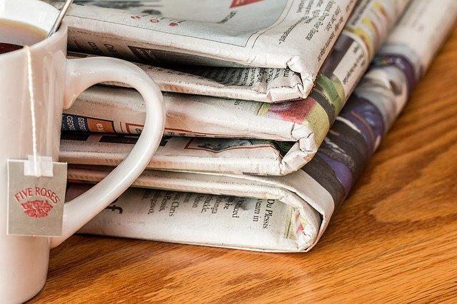 Newspaper and coffee mug